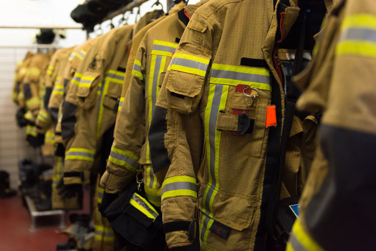 Midsection of firefighting uniforms