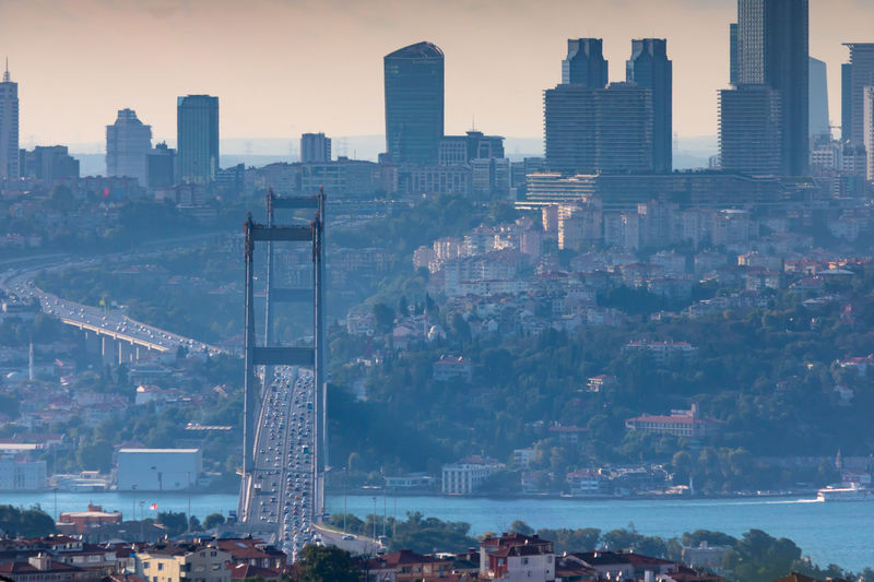 Bosphorus Bridge and Skyscrapers Building Exterior Built Structure Architecture Building Cityscape City Office Building Exterior Skyscraper Sky Crowd Urban Skyline Tower Residential District Crowded Tall - High Landscape Nature High Angle View Outdoors Modern Financial District  Settlement Spire  Bridge - Man Made Structure Istanbul