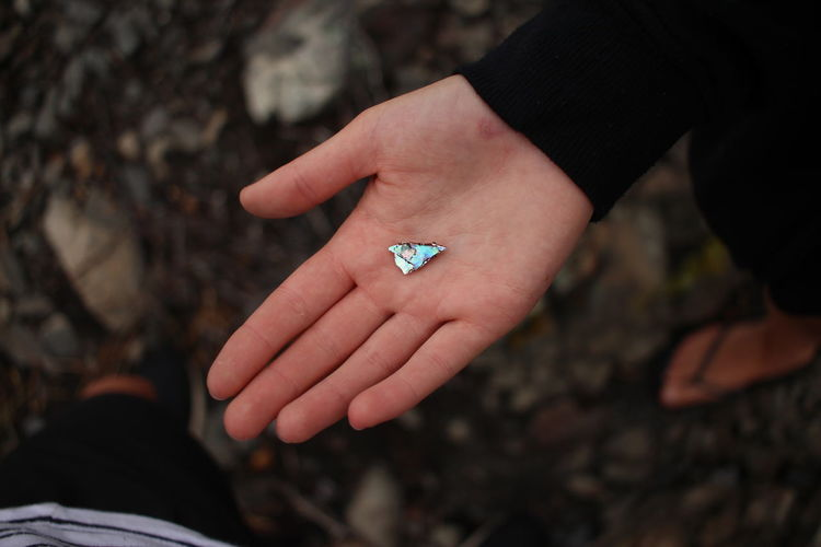 Cropped Hand Holding Mineral