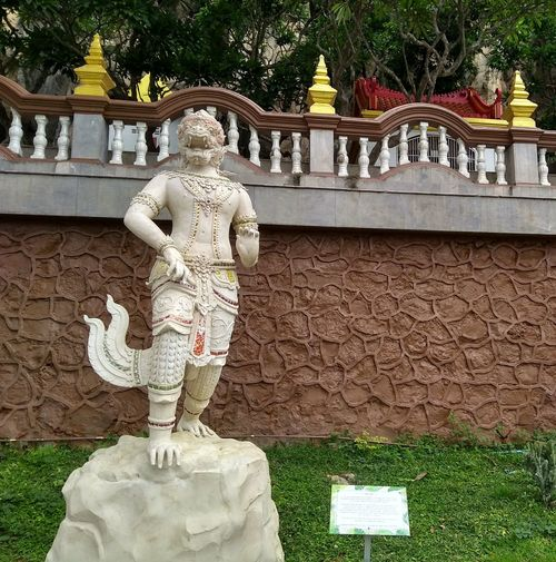 Statue of buddha against temple