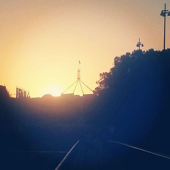 Sunset Parliamenthouse Parliment Australia canberra evening dusk fire sun blue sky summerporn treeporn instagram