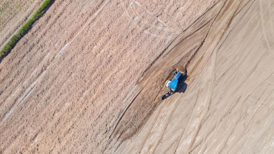High angle view of man skiing on land