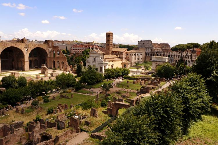 An aerial view of the ruined remains of the ancient roman forum (foro romano) in the centre of the city of Rome, Italy with the Colosseum in the background Cityscape Ruins Tourist Attraction  Travel Photography Ancient Ancient Civilization Ancient Rome Architecture Building Building Exterior Built Structure City Cloud - Sky Day Europe Foro Romano History Nature No People Outdoors Residential District The Past Tourist Destination Travel Travel Destination