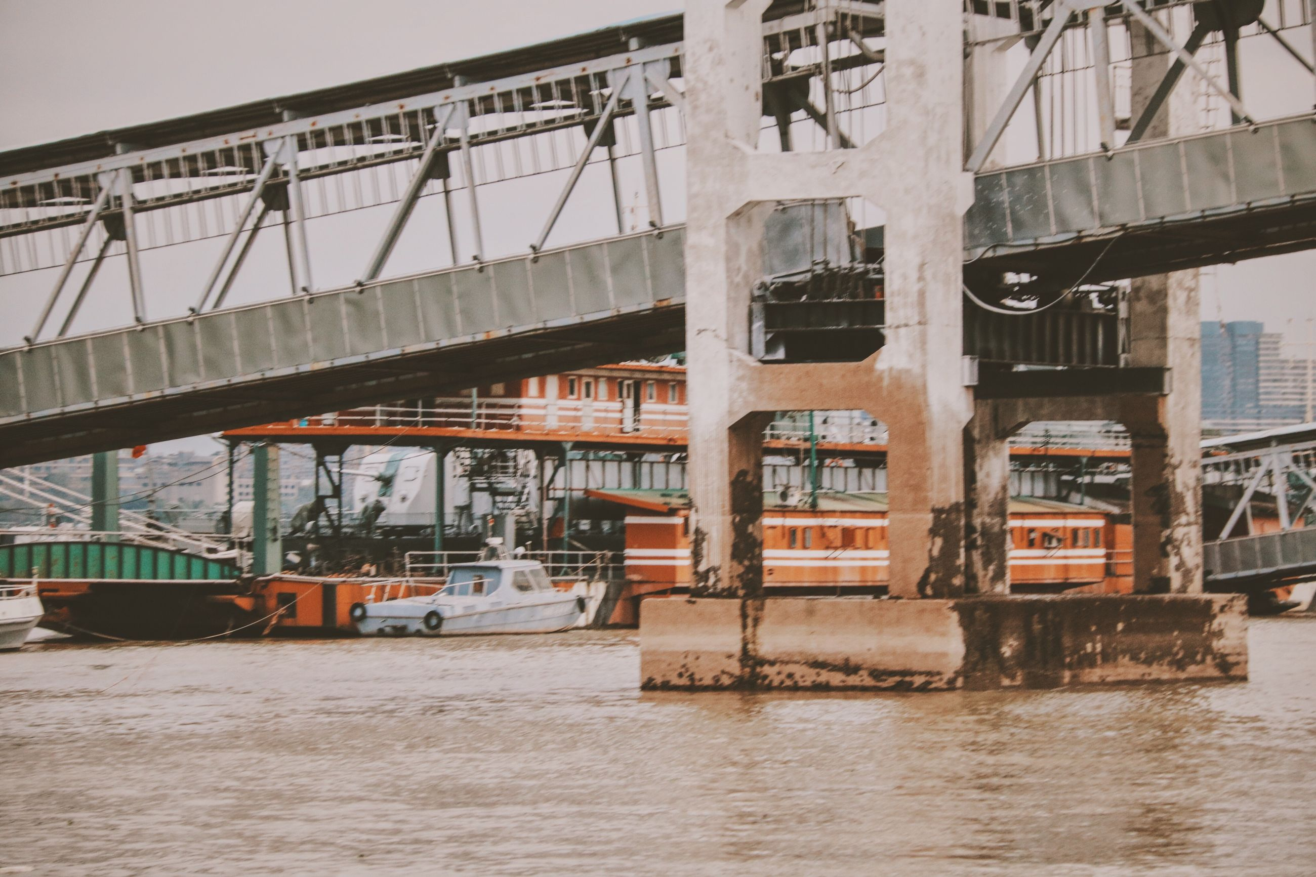 bridge - man made structure, transportation, water, river, business finance and industry, no people, nautical vessel, outdoors, day, sky