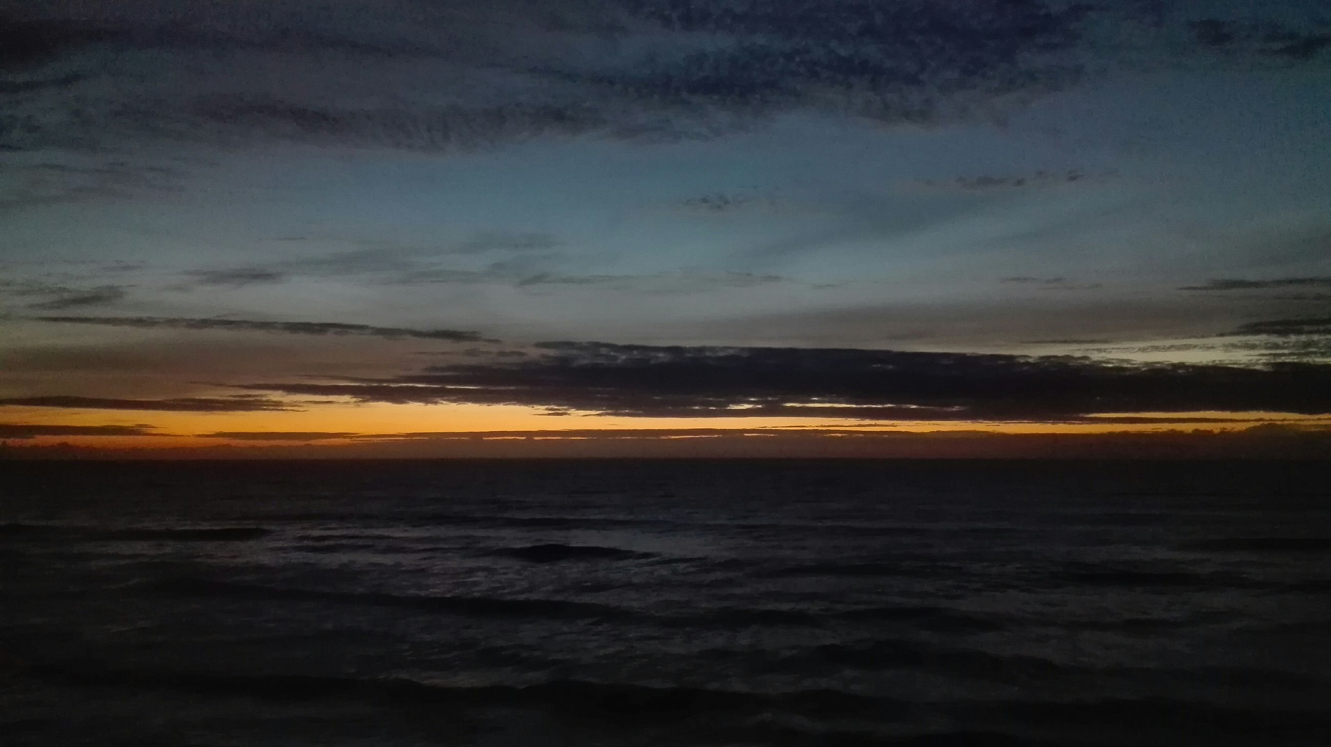 sea, sunset, scenics, tranquil scene, beauty in nature, tranquility, horizon over water, water, sky, nature, idyllic, cloud - sky, beach, orange color, cloud, dusk, shore, dramatic sky, cloudy, seascape
