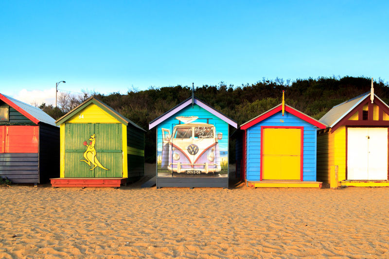 Designs of the Brighton Beach bathing boxes Architecture Art And Craft Beach Beach Hut Blue Building Exterior Built Structure Clear Sky Copy Space Creativity Day Hut Land Multi Colored Nature No People Outdoors Sand Sky Sunlight