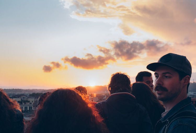 Group of people against sky during sunset