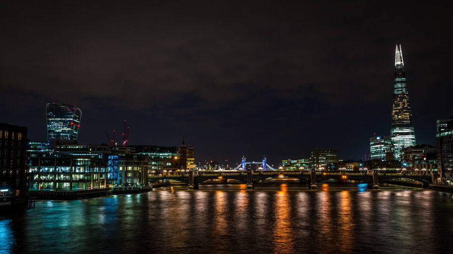 Illuminated Shard London Bridge And Cityscape By Thames River At Night