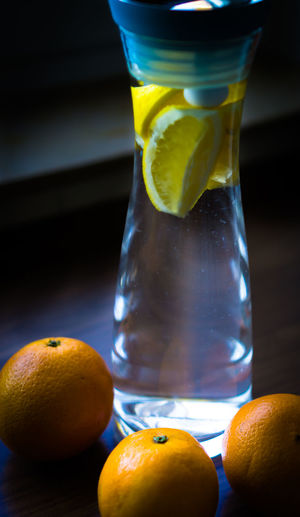 Food And Drink Healthy Eating Fruit Food Freshness Drink Table Refreshment Glass Drinking Glass Citrus Fruit Still Life No People Orange Color Transparent Close-up Wellbeing Indoors  Orange Glass - Material Ripe Fruit Juice Temptation Lemon Water Lemon Water Wasser Zitrone Yellow