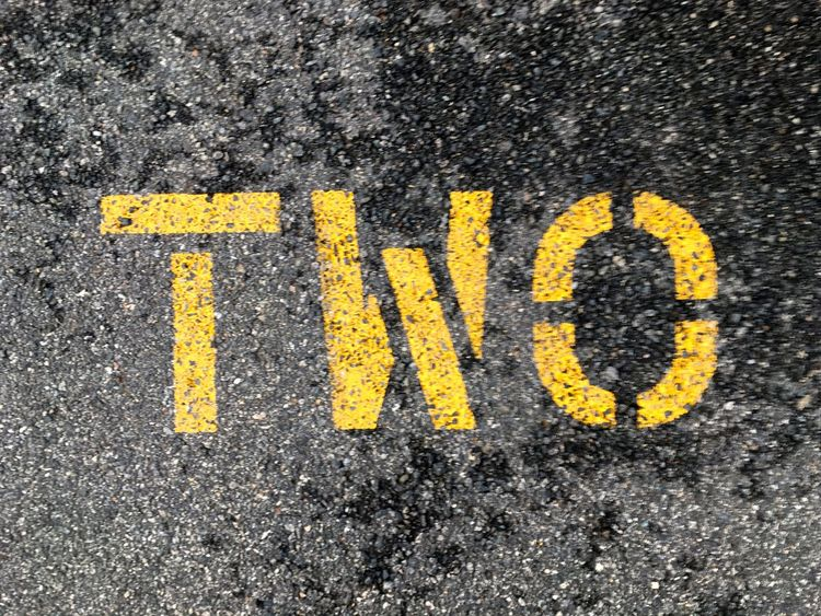 Asphalt Black Color Close-up Day Detail Directional Sign Full Frame Ground Information Information Sign Letter O Letter T Letter W Nature No People Outdoors Road Road Marking Road Sign Stencil Two Typography Yellow