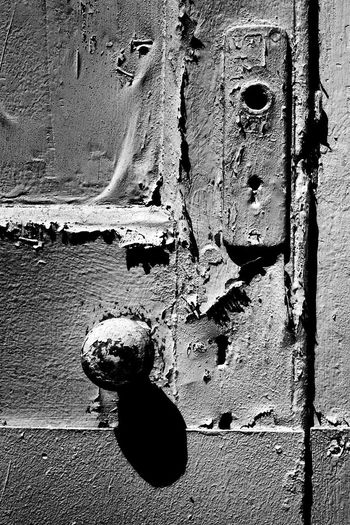 Black and White Door Knob, cracked paint and shadow. Textured  Full Frame Backgrounds Close-up Abstract Pattern Architecture No People Day Outdoors Beautiful Penang, Malaysia Nawfal Doors And Windows Around The World Door Knob And Shadow Black And White Black & White City Illuminated Wall Decay Decay