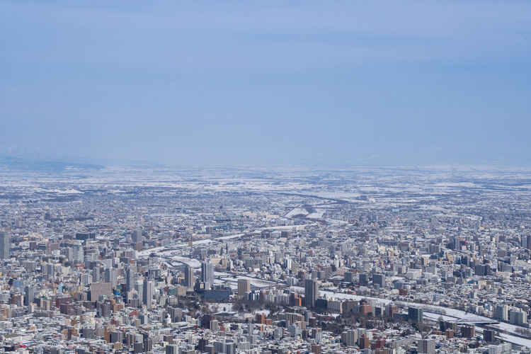 City Building Exterior Cityscape Architecture Built Structure Sky Crowded Residential District Crowd Building Nature Aerial View Day High Angle View Copy Space Outdoors Travel Destinations Environment Office Building Exterior Skyscraper Settlement Sapporo Hokkaido Japan
