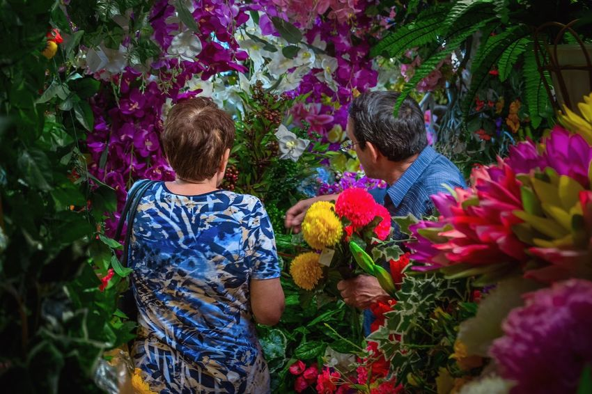 "- OUR HUMANS - Mr. and Mrs. Penkwitz from Berlin ""Alt Pankow"" are married since 45 years and they share the same big passion. They are crazy for plastic flowers. The Portraitist - 2018 EyeEm Awards Check This Out PortraitPhotography Portrait Couple - Relationship Couple Colourful Colors Passion Fake Flowers Plastic Flower Flowers Plants Plant Flower Flowering Plant Real People Nature Growth Men Day Lifestyles Two People Leisure Activity Rear View Freshness Multi Colored Be Brave"
