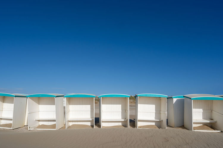 Along the beach of the netherlands you can find lots of beach houses and cabins.