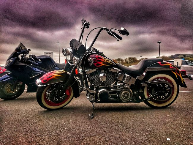 Motorcycle Transportation Land Vehicle Outdoors Sky No People Motorcycles Motorcycle Photography For Friends That Connect  Hello Darkness My Old Friend Motorcycleporn Motorcyclelifestyle USA Customized 2 Wheels Chop Flame Flame Patterns Ride Low Harleydavidson Harley Davidson USA Monster Harly Fashion Stories This Is Family