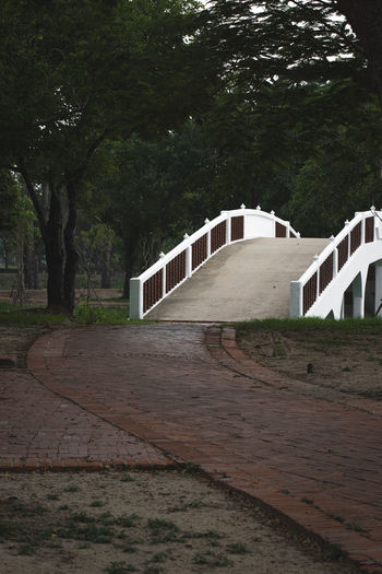 View of footpath with bridge in background