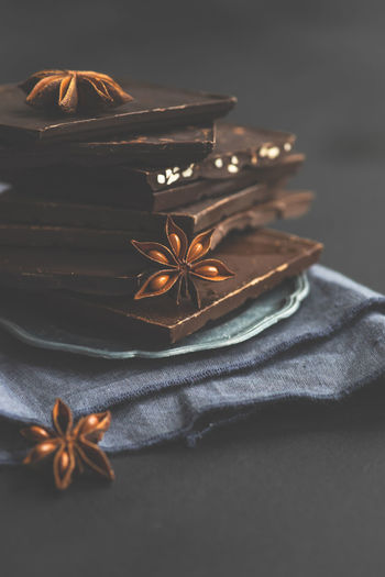Close-up of chocolate bars with star anise on table