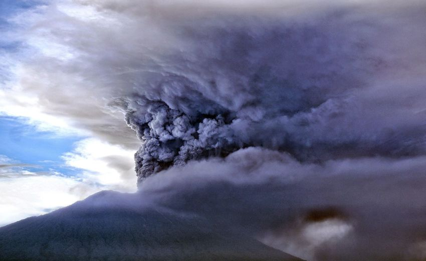 Eruption of Agung Volcano in Bali, Indonesia. The Photojournalist - 2018 EyeEm Awards Active Volcano Beauty In Nature Cloud - Sky Cold Temperature Day Environment Erupting Geology Landscape Mountain Mountain Peak Nature No People Non-urban Scene Outdoors Power Power In Nature Scenics - Nature Sky Smoke - Physical Structure Snowcapped Mountain Volcanic Crater Volcano