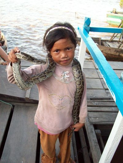 Child Water Portrait Looking At Camera Girls Tonlesap Cambodia Travel Outdoors Real People