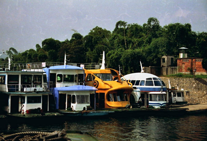 Unusual Boats, Zhujiang Pier Boats China Cloud - Sky Composition Day Ferries Fun Mode Of Transport Multi Coloured Nautical Vessels No People Outdoor Photography Outdoors River Side By Side Stationary Sunlight And Shadows Tourism Tourist Attraction  Tourist Destination Transportation Tree Unusual Water Zhujiang