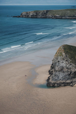 Cornwall, UK Beach Beach Day Beauty In Nature Bedruthan Steps Coastline Cornwall Day Horizon Over Water Land Motion Nature No People Ocean Outdoors Rock Rock - Object Sand Scenics - Nature Sea Sky Solid Tranquil Scene Tranquility Two People Water