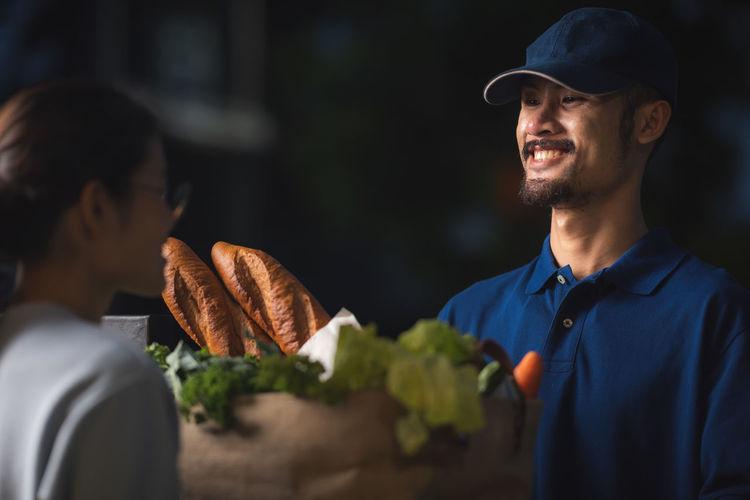 Portrait of smiling man eating food