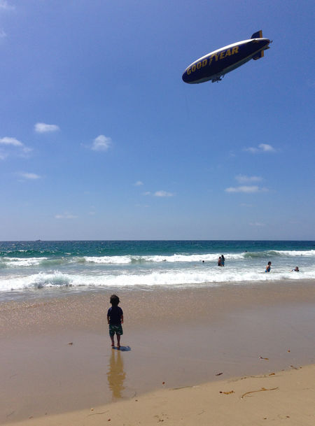 Beach Blimp Day Horizon Over Water Leisure Activity Outdoors Real People Sand Scenics Sea Shore Sky Summer Vacations Water Wave Live For The Story