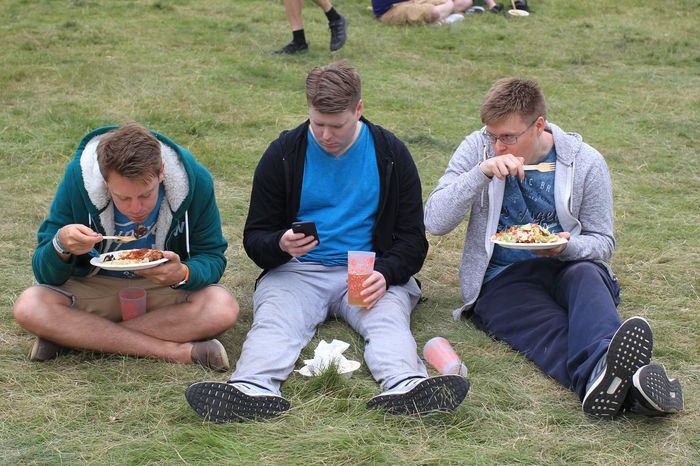 Scenes from the 2016 Latitude festival in Southwold, Suffolk. Casual Clothing Day Eating Festival Field Friendship Grass Grass Latitude Latitude Festival Latitudefestival Leisure Leisure Activity Lifestyles Nap Outdoors Relax Relaxation Sitting