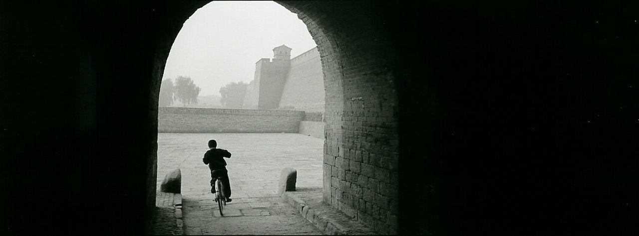 Boy Riding A