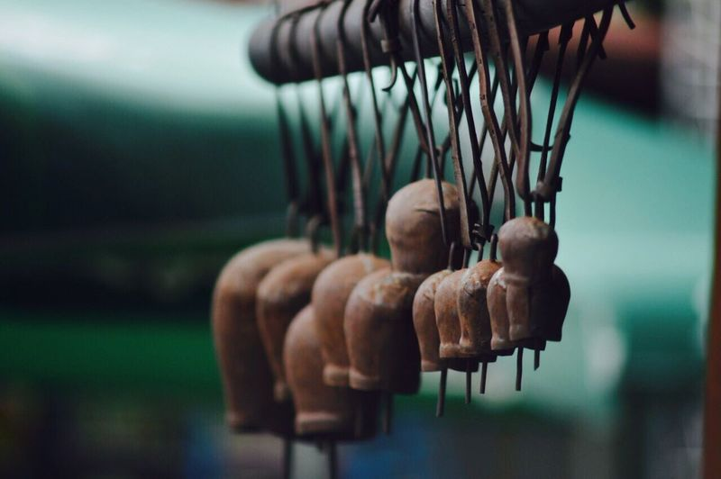 Close-up of hand hanging outdoors