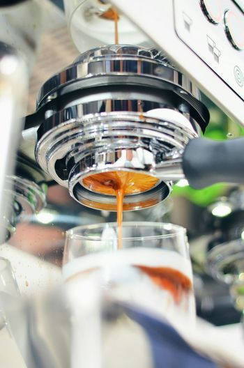 Close-Up Of Espresso Machine Pouring Coffee Into Cup