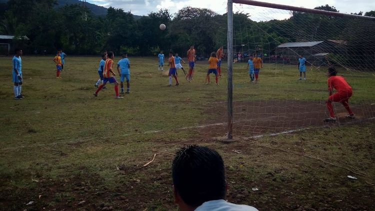 Festive match between Barcelona and Man City at Ometepe Island, Nicaragua. Lots of pigs and chickens invasion during the encounter. Nicaragua Ometepe Island Football Field