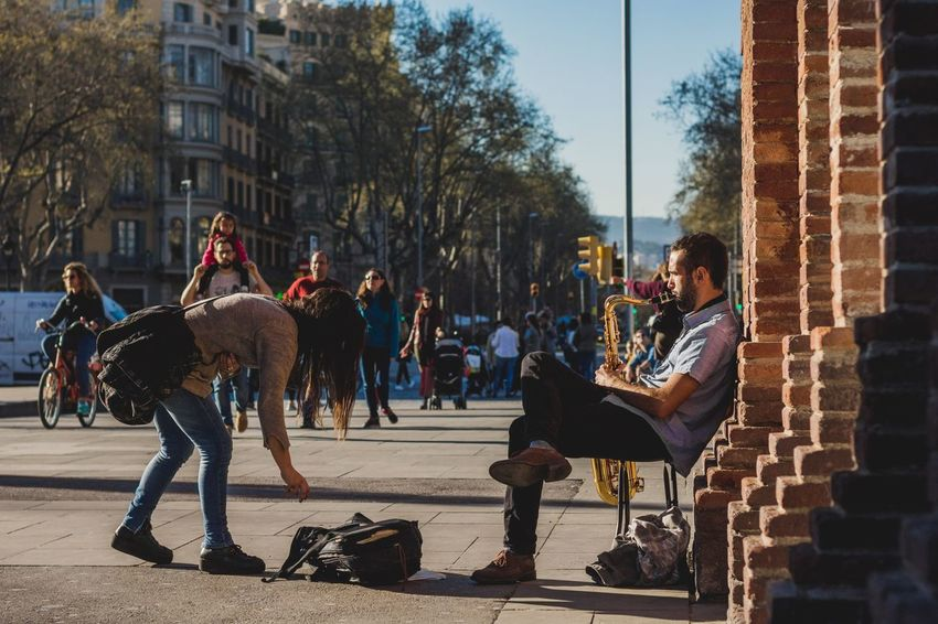 Tree City Built Structure Outdoors People Day Architecture One Person Adult Adults Only Only Men Sky Young Adult Barcelona Portrait Of A City Saxophone Saxophonist Vacations Live Performance  Street Photography Street Performer Contribution Art Musician City Street The Street Photographer - 2017 EyeEm Awards