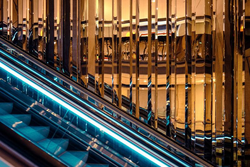 Escalator against glass wall