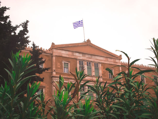 Old Royal Palace, Syntagma Square, Athens Greece Architecture Athens Building Exterior Built Structure Flag Greece Greek Flag Low Angle View No People Old Royal Palace Outdoors Parliament Building Parliament House Plant Syntagma Syntagma Square Tree