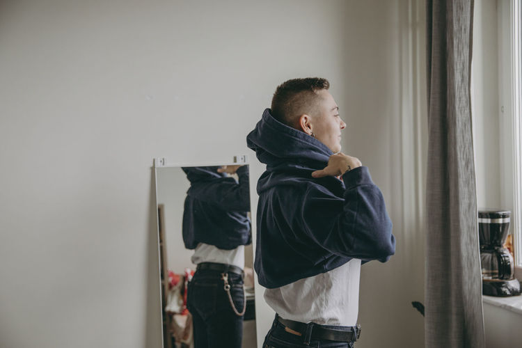 Side view of young man looking at home
