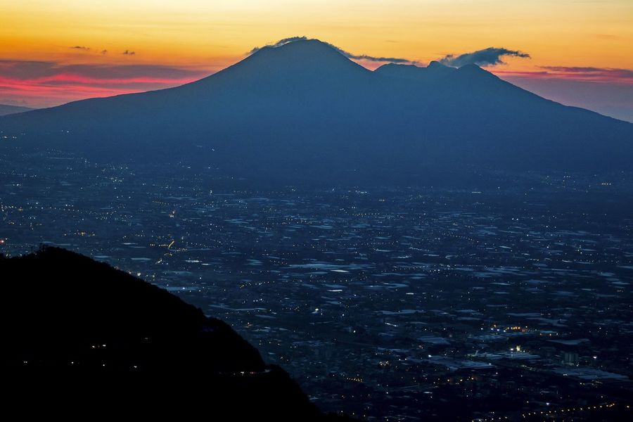 A view of Mount Vesuvius and the Gulf of Naples from the car park on the road to Corbara Beauty In Nature Cityscape Dusk Landscape Mountain No People Scenics Sky Sunset Travel Destinations Twilight Vesuvio Volcano Volcano Landscape Been There. Lost In The Landscape
