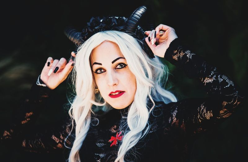 Portrait of beautiful woman in halloween costume standing outdoors