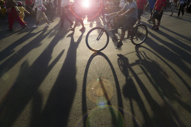 Low section of people riding bicycle on street