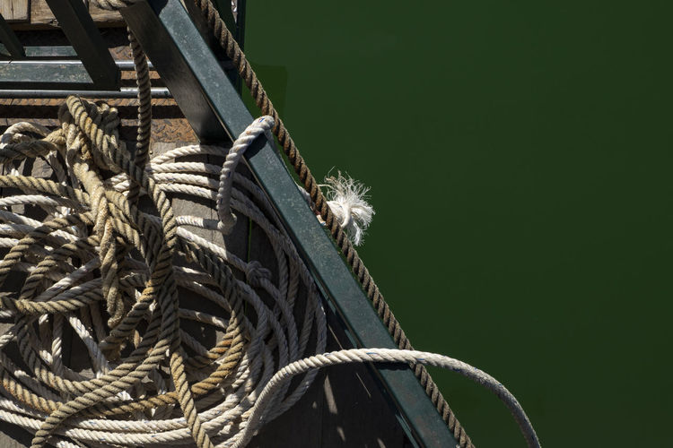 Low angle view of rope tied up of metallic structure