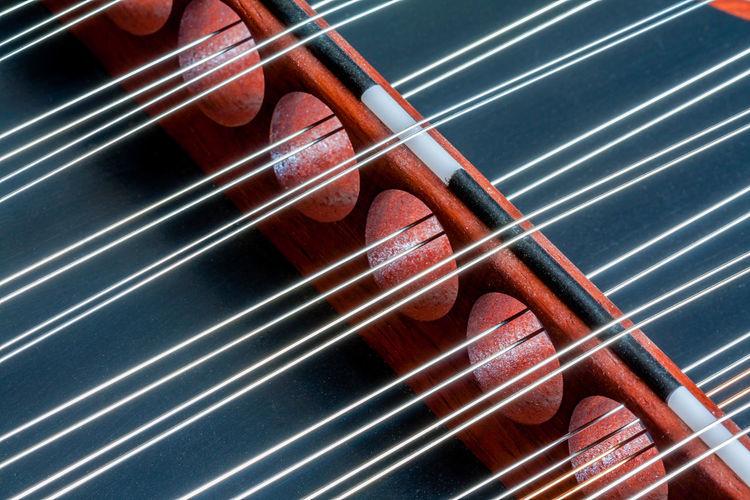 Bridge of Strings Hammer Dulcimer Holes Close-up Diagonal' Music Musical Instrument Musical Instrument String Red String Instrument Strings