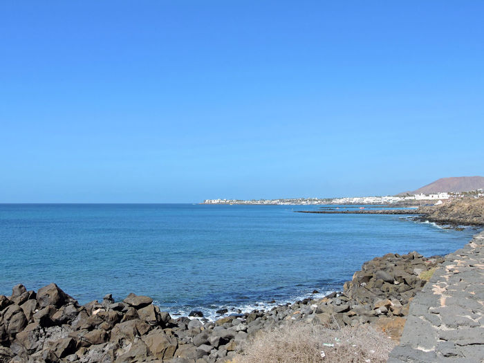 Beach Beauty In Nature Blue Blue Sky Canary Islands Clear Sky Day Lanzarote Nature Outdoors Playa Blanca Rocks Sea Sky SPAIN Travel Destinations Water