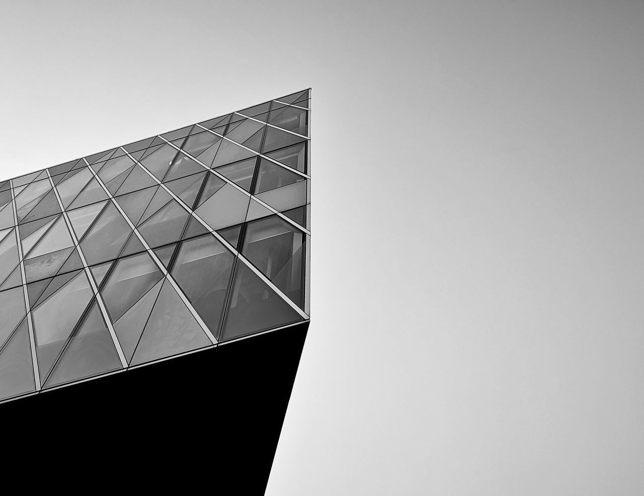 built structure, architecture, building exterior, sky, copy space, building, low angle view, clear sky, no people, city, day, nature, office building exterior, glass - material, office, modern, outdoors, geometric shape, pattern, window