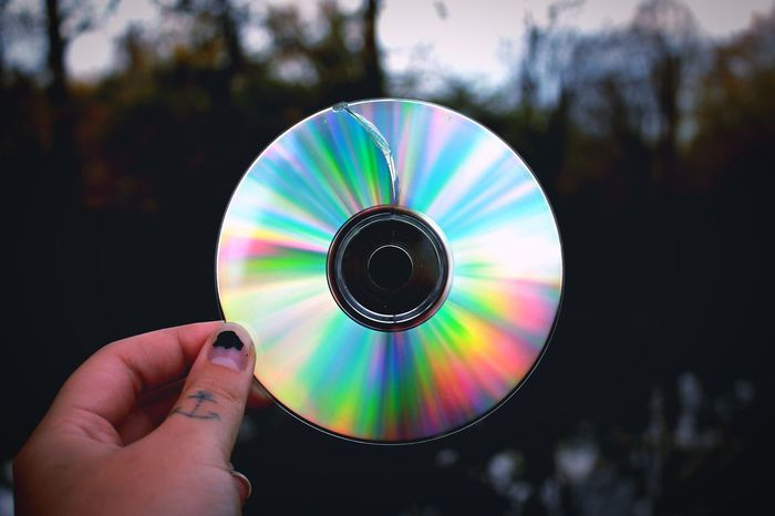 Rainbow Colors Reflection Cd Human Hand Hand Holding Human Body Part One Person Focus On Foreground Shape