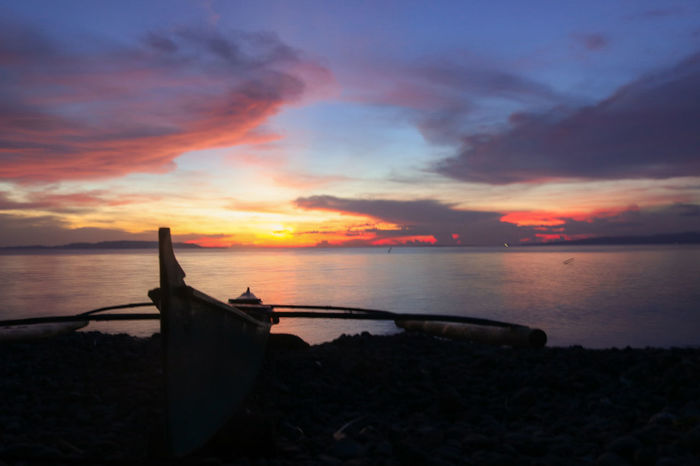 i was doing fieldwork when the sunset turns so gorgeous that i needed to rush to the shore just to capture it Sunset Reflection Sea Romantic Sky Vacations Beach Cloud - Sky Sky Landscape Outdoors Dramatic Sky Water No People Horizon Over Water Canonphotography Eyeem Philippines Sunsets Colorful Sky Sunset Silhouettes Sunset And Boat Eyeem Leyte