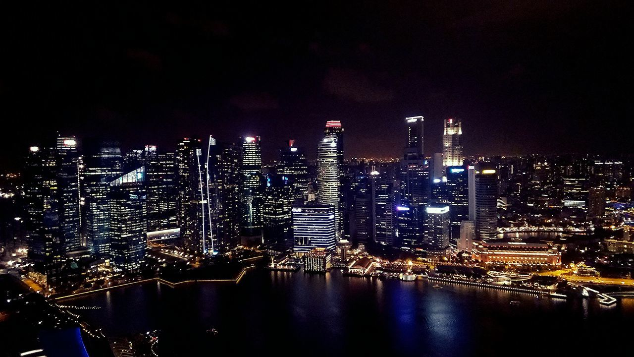 illuminated, architecture, night, building exterior, built structure, city, cityscape, no people, skyscraper, sky, river, travel destinations, outdoors, modern, water