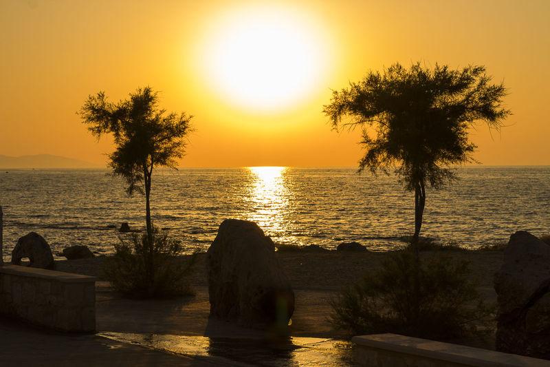 Aegean Sea Analipsi Beach Beauty In Nature Crete Heraklion Hersonissos Horizon Over Water Idyllic Nature No People Orange Color Outdoors Scenics Sea Silhouette Sky Sun Sunlight Sunset Tranquil Scene Tranquility Travel Destinations Tree Water