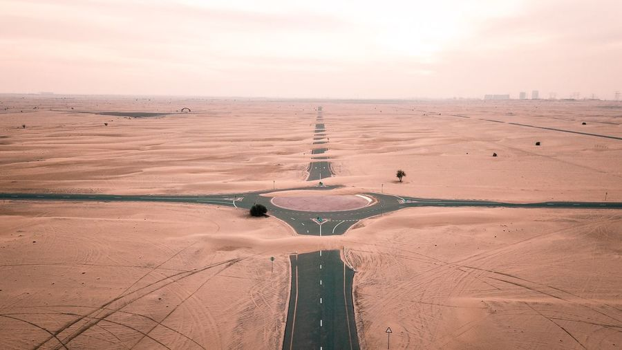 Aerial View Of Traffic Circle At Desert Against Sky During Sunset