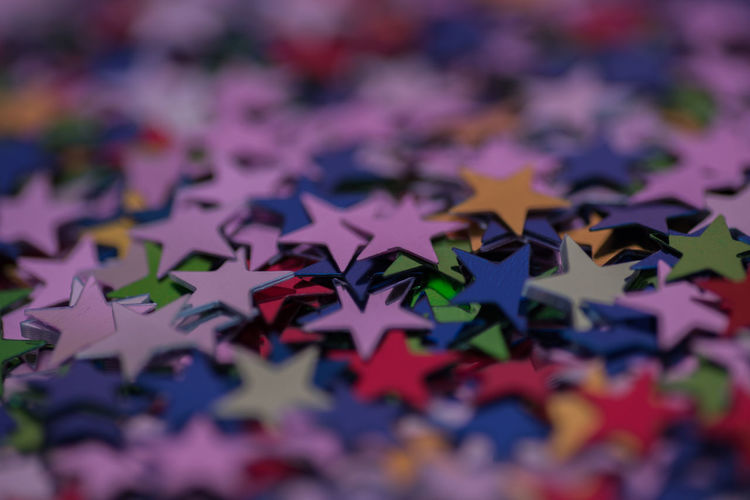 Stars Selective Focus Full Frame Close-up Backgrounds No People Multi Colored Indoors  Puzzle  Large Group Of Objects Still Life Abundance Pattern Jigsaw Puzzle Shape Connection Star Shape Design Red Creativity