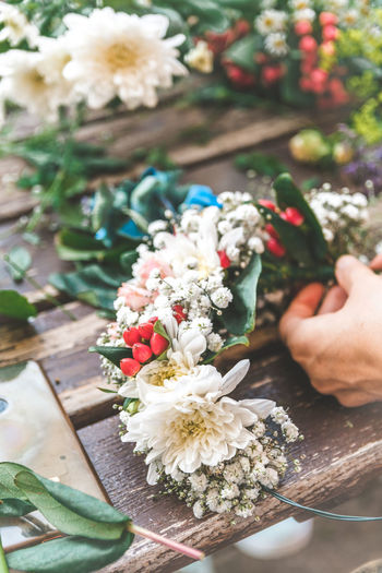 Flower Wreath Human Hand Human Body Part Hand Flower Flowering Plant Plant Freshness One Person Real People Holding Nature Beauty In Nature Flower Arrangement Lifestyles Bouquet Body Part Close-up High Angle View Vulnerability  Flower Head Finger